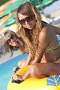 Free Two Ladies Lying On Inflatable Ring Stock Image - 16967501