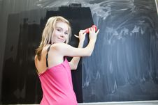 Free Student Erasing The Chalkboard/blackboard Stock Photo - 16960450