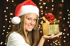 Free Girl Smiles With Open Gift Royalty Free Stock Photos - 16960548