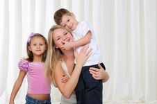 Young Mother, Her Daughter And Son Stock Image