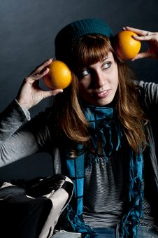 Free Beautiful Girl With Scarf And Hat And Oranges Royalty Free Stock Photos - 16960798