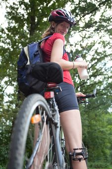 Free Female Biker  On Her Mountain Bike Royalty Free Stock Image - 16961426
