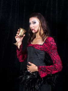 Free Vampire Girl With Goblet Of Blood Royalty Free Stock Photos - 16961948