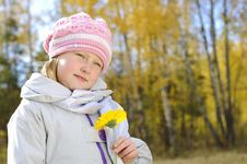 Free Little Girl With A Yellow Flower Stock Photography - 16962802