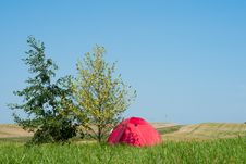 Tourist Tent In The Field With Road And Hills Royalty Free Stock Photo