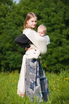Free Mother Carrying Daughter Royalty Free Stock Images - 16964489