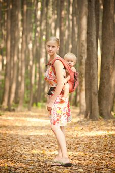 Free Mother Carrying Daughter Royalty Free Stock Photography - 16964497