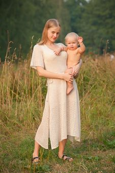 Mother Holds Smiling Baby Royalty Free Stock Image