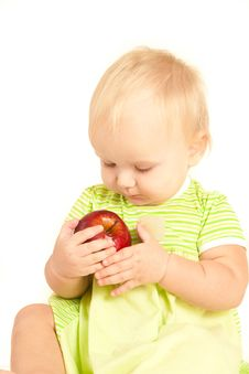 Little Baby Eat Red Apple Stock Photography