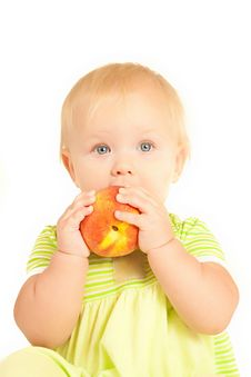 Little Baby Eat Red Peach Royalty Free Stock Photo