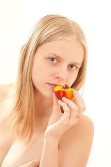 Girl Eating A Peach Royalty Free Stock Photos