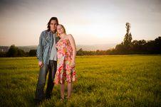 Free Lovely Couple Flirt In Field On Sunset Stock Photo - 16964710