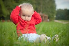 Baby Sit On Green Grass In Park Royalty Free Stock Photography