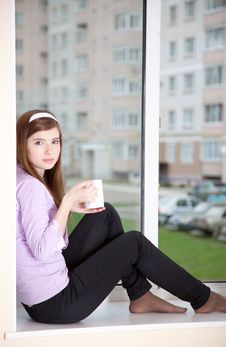 A Girl Is Sitting On The Window-sill Stock Photography