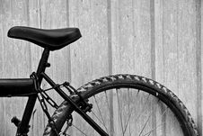 Abandoned Bicycle By A Fence Royalty Free Stock Photos