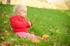 Adorable Baby Sit On Green Grass In Hill Royalty Free Stock Images