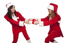Free Santas Take From  Each Other A Gift Box Stock Photos - 16967263
