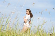 Free Young Cute Girl In A Field Royalty Free Stock Photography - 16967467