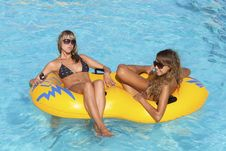 Free Two Ladies Lying On Inflatable Ring Royalty Free Stock Images - 16967489