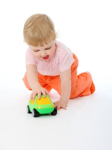 Free Baby Playing With A Toy Car Royalty Free Stock Photo - 16967545