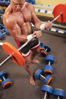 Free Muscular Man With A Bar Weights In Hands Training Stock Image - 16967601