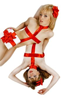 Two Female Dolls Tied With Gift Red Ribbon