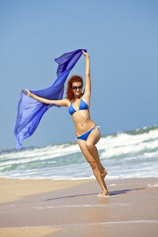 Free Young Girl Runs With Blue Shawl Stock Photo - 16968070