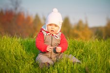 Free Adorable Baby Sit Near Top Of Hill Royalty Free Stock Photography - 16968637