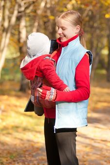 Free Young Adorable Mother Carry Toddler Baby In Park Stock Photo - 16968740