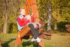 Free Mother Swinging With Dughter In Autumn Park Royalty Free Stock Photo - 16968745