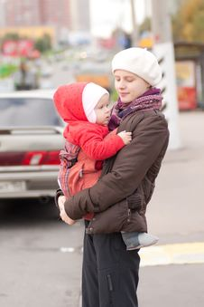 Mother And Toddler Girl Stay On Crossroad Stock Photo
