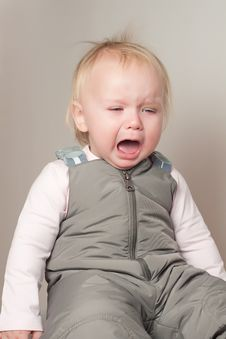 Crying Young Baby Sit On Chair Stock Images