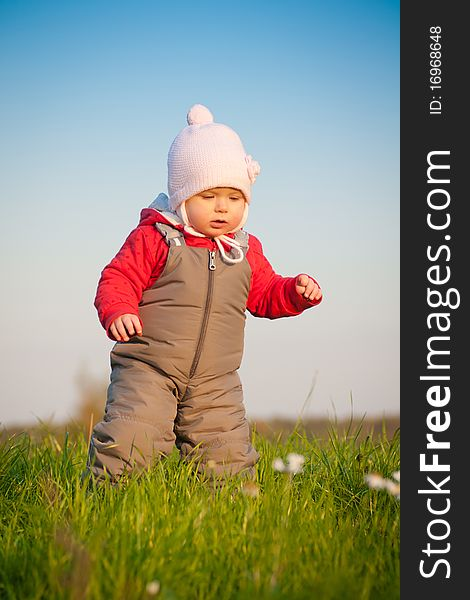 Adorable baby walk on top of hill
