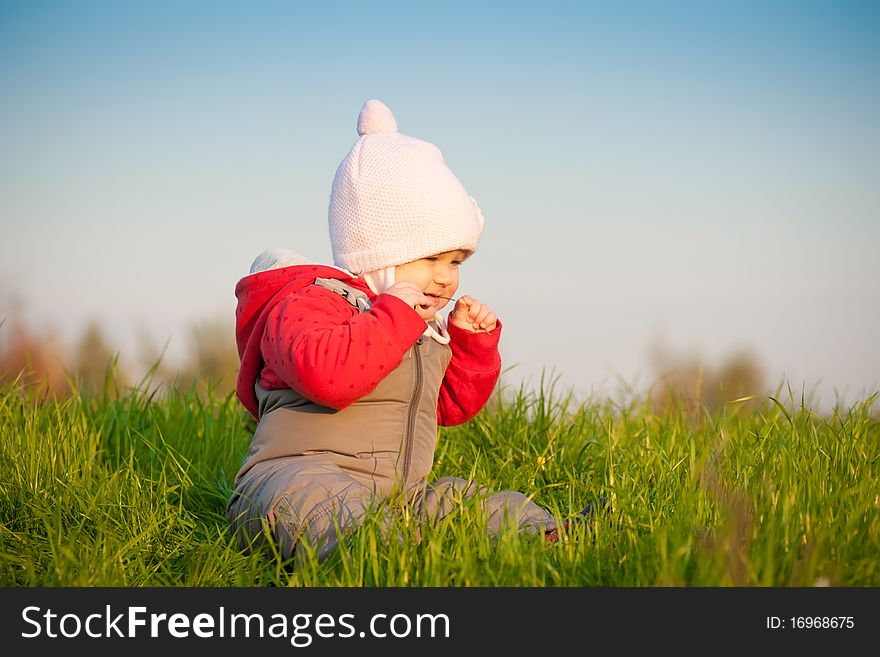 Baby sit on top of hill and taste grass