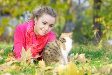 Free Attractive Girl And Cat On Nature Royalty Free Stock Image - 16974106