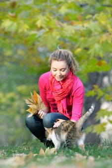 Free Attractive Girl And Cat On Nature Stock Image - 16974161