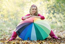 Free Young Happy Girl With Colorful Umbrella On Nature Royalty Free Stock Image - 16974216