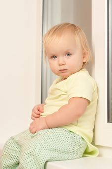 Girl Sitting On The Window Sill Royalty Free Stock Images