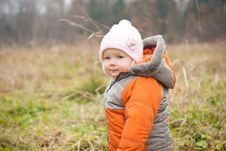 Baby Stay In Field In Autumn Park Royalty Free Stock Photography