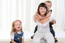 Young Mother, Her Daughter And Son Royalty Free Stock Photo