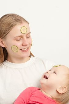 Free Mother With Daughter Play With Cucumbers Stock Photography - 16975312