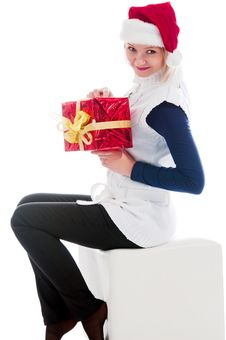 Free Christmas Girl Sits And Hold A Gift Royalty Free Stock Photos - 16975638