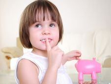 Free Little Girl Hides Her Money Stock Image - 16977261