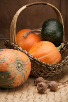 Free Ripe Pumpkins In Woven Basket And Poppy On Table Stock Image - 16977281