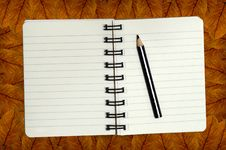 Free Mini Notebook On Leaf Pattern Stock Images - 16978144