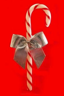 Free Candy Cane With Silver Bow Over Red Royalty Free Stock Photography - 16985667