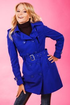 Lovely Woman In A Blue Coat Royalty Free Stock Photos