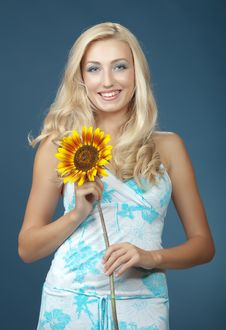 Free The Beautiful Girl With A Sunflower Royalty Free Stock Photo - 16986105