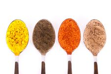 Free Spoons With Spices Across White Royalty Free Stock Photo - 16987365