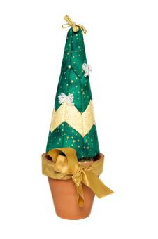 Artificial Christmas Tree In Pot With Gold Bow Stock Image